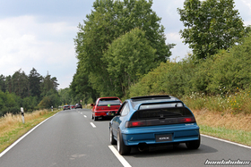 Red Honda Civic EF9 and blue CRX EF8 on a country road