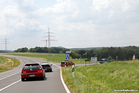 A Group of Honda Civic EF9 and CRX EF8 turns off a country road