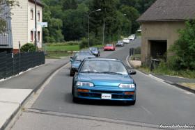 Celestial Blue Honda CRX EF8 drives in the convoy through a village