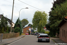 Various Honda CR-X drive over a tip in a village