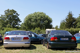 Rear View of a silver and a grey EJ EK Civic Ferio