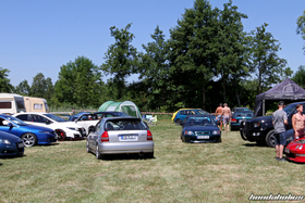 Silver and green Civic in front of other Hondas at the HP-Meet