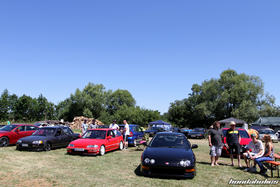 Two EF-Civics stand beside a Integra Type R