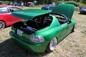 Green Honda Del Sol EG2 with opened electric roof