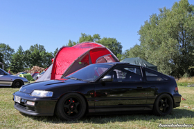 Black Honda CRX ED9 in front of a tent